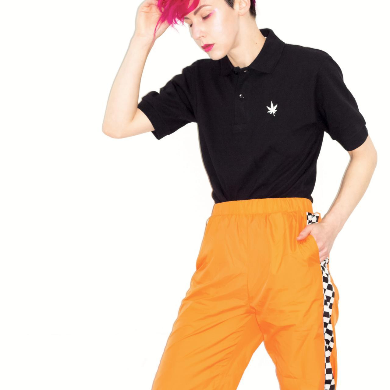 Product Image 1 - Here is a black polo-style,